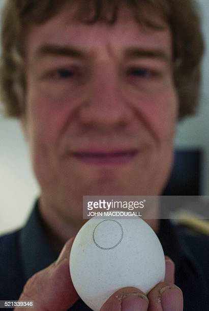 Project coordinator Dr Gerald Steiner of the Carl Gustav Carus Faculty of Medicine at the Dresden Institute of Technology poses with an egg as he...