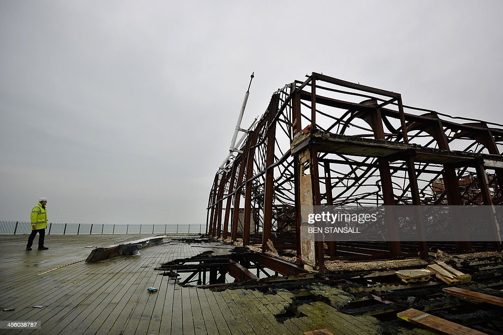 Project manager David Spooner surveys the remains of the ballroom on the burnt-out remains of Hastings Pier in Hastings, southern England, on December 13, 2013 ahead of the start of a multi-million pound regeneration project. Hastings Pier was originally constructed in opulent style in the late 19th century seeing its heyday in the 1930s and hosting music concerts by major artists including The Rolling Stones in the 1960s and 70s. After undergoing various additions and re-construction to repair storm and fire damage throughout the 20th century the Victorian pier finally suffered a devastating fire in 2010 which destroyed much of the superstructure leaving just a burnt out shell. Following a Heritage Lottery Fund (HLF) grant and money from other funds a 14 million GBP regeneration project is set to begin work on January 6, 2014.