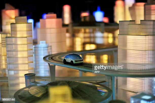 A project model shows a possible future transport system in the Pavilion of Future as organisers of Shanghai's World Expo gave members of the public...