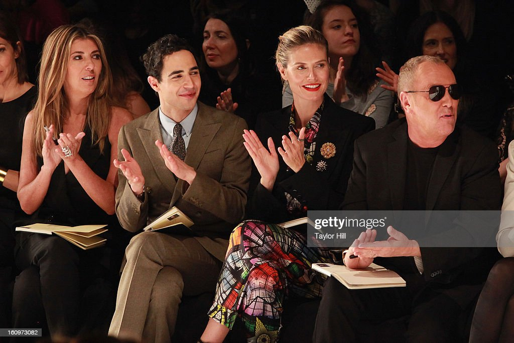 Project Runway judges <a gi-track='captionPersonalityLinkClicked' href=/galleries/search?phrase=Nina+Garcia&family=editorial&specificpeople=592222 ng-click='$event.stopPropagation()'>Nina Garcia</a>, Zac Posen, and <a gi-track='captionPersonalityLinkClicked' href=/galleries/search?phrase=Heidi+Klum&family=editorial&specificpeople=178954 ng-click='$event.stopPropagation()'>Heidi Klum</a>, and designer Michael Kors, attend the Project Runway Fall 2013 Mercedes-Benz Fashion Show at The Theater at Lincoln Center on February 8, 2013 in New York City.