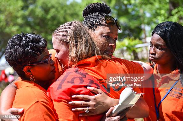 Project Street Outreach activists J Denise Cromwell left her daughter Asia Cromwell center and Danielle Richardson far right console Tiffany Williams...