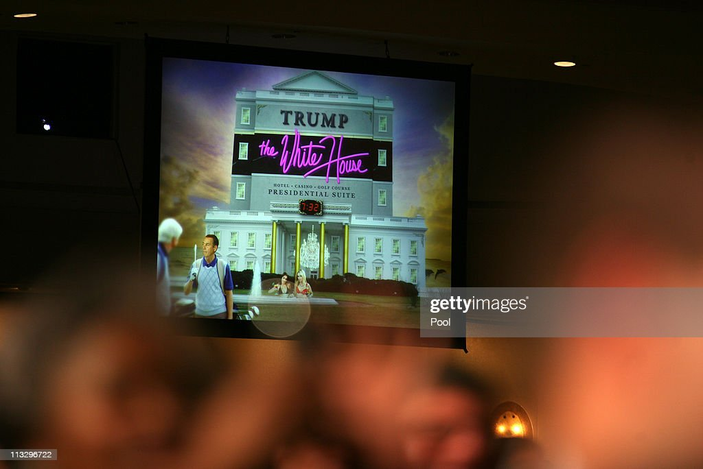 A projected image is shown on a large screen during US President Barack Obama's speach at the annual White House Correspondent's Association Gala at the Washington Hilton hotel April 30, 2011 in Washington, DC. The president used the image to show what a 'Trump' White House might look like.