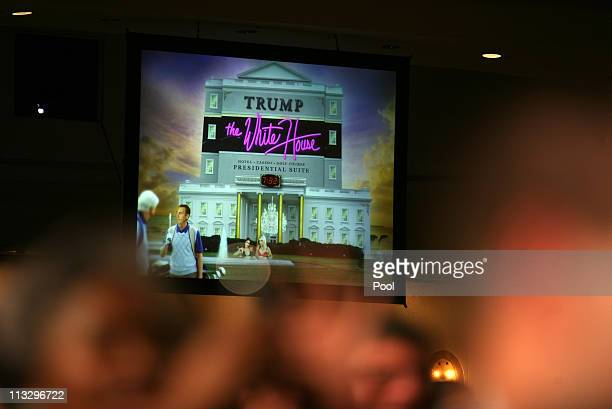 A projected image is shown on a large screen during US President Barack Obama's speach at the annual White House Correspondent's Association Gala at...