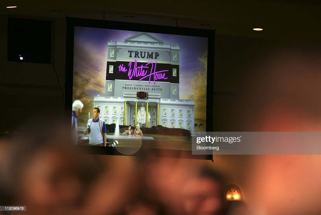 A projected image is shown on a large screen during U.S. President Barack Obama's speech at the annual White House Correspondents' Association (WHCA) dinner in Washington, D.C., U.S., on Saturday, April 30, 2011. The dinner raises money for WHCA scholarships and honors the recipients of the organization's journalism awards. Photographer: Martin H. Simon/Pool via Bloomberg