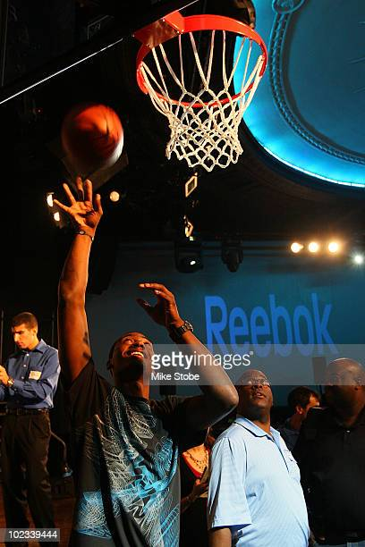 Projected NBA draft pick John Wall shoots hoops during a press conference to unveil his new stateoftheart Reebok basketball shoe ZigTech Slash at...