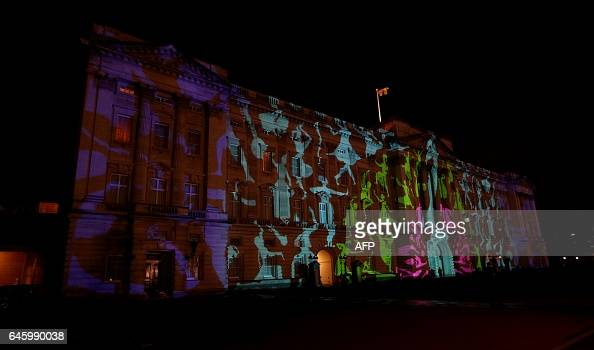 A projection designed by Studio Carrom of a peacock and dancing figures is seen during a reception to mark the launch of the UKIndia Year of Culture...