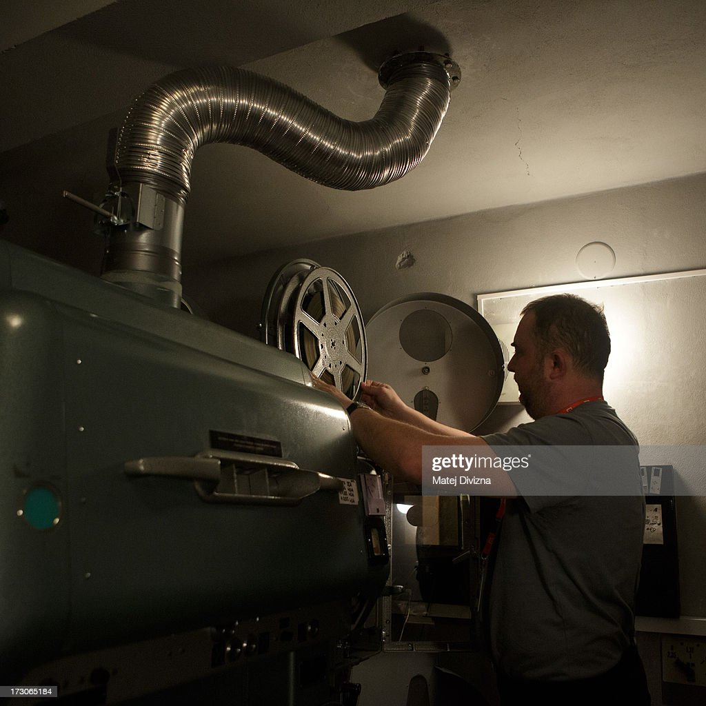 A projectionist prepares film for screening during the 48th Karlovy Vary International Film Festival (KVIFF) on July 06, 2013 in Karlovy Vary, Czech Republic.