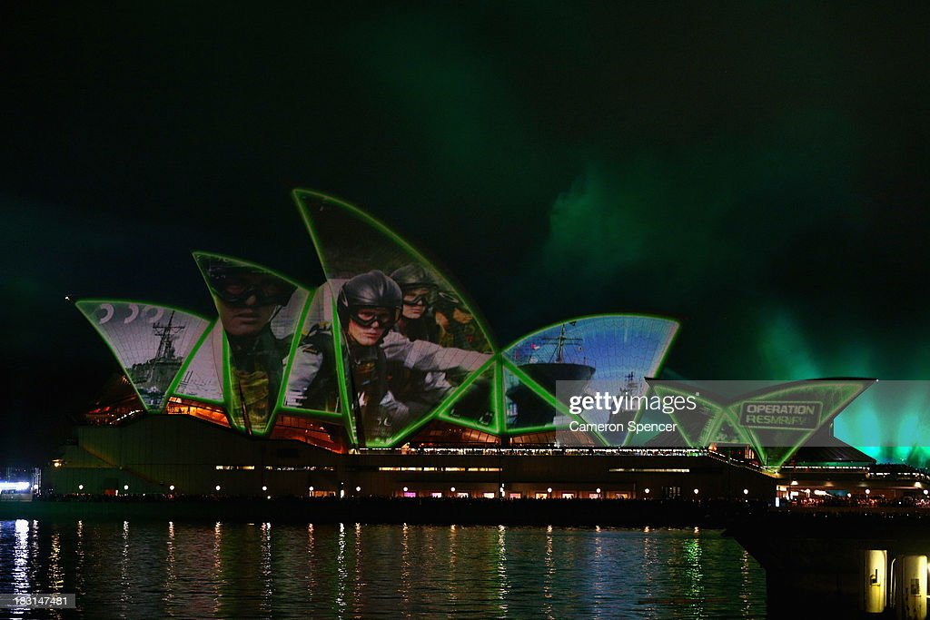 Projections are displayed on the Sydney Opera House during the International Fleet Review on October 5, 2013 in Sydney, Australia. Over 50 ships participate in the International Fleet Review at Sydney Harbour to commemorate the 100 year anniversary of the Royal Australian Navy's fleet arriving into Sydney. Prince Harry is an official guest of the Australian Government and will take part in the fleet review during his two-day visit to Australia.