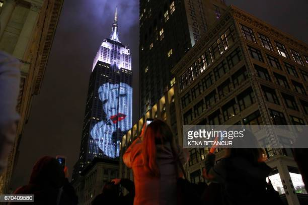 TOPSHOT Projections are seen on the Empire State Building celebrating Harper's Bazaar magazine's 150th anniversary on April 19 2017 in New York / AFP...