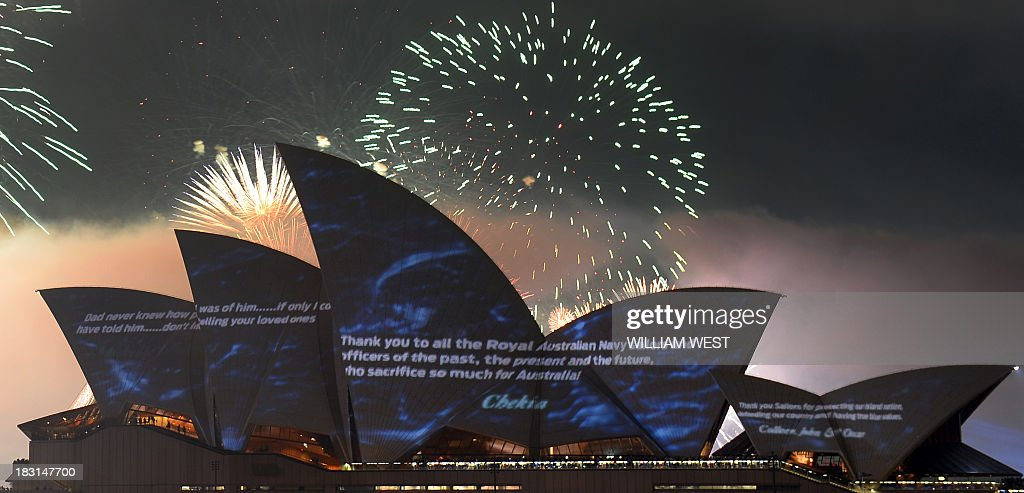 Projections light up the Sydney Opera House sails with the history of the Royal Australian Navy as they celebrate 100 years since their first ships entered Sydney Harbour, on October 5, 2013. Prince Harry is in Sydney for the Royal Australian Navy International Fleet Review with visiting warships from Britain, Singapore, Japan, India, Thailand and the United States joining ships from the Australian Navy. AFP PHOTO/William WEST / AFP / WILLIAM