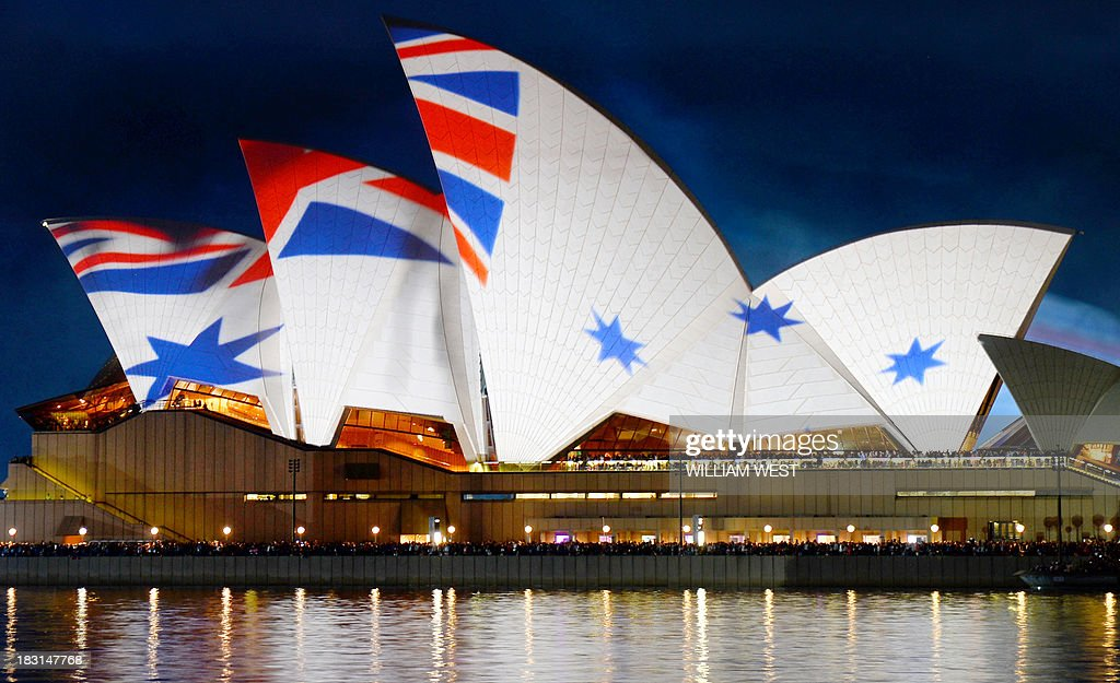Projections light up the Sydney Opera House sails with the history of the Royal Australian Navy as they celebrate 100 years since their first ships entered Sydney Harbour, on October 5, 2013. Prince Harry is in Sydney for the Royal Australian Navy International Fleet Review with visiting warships from Britain, Singapore, Japan, India, Thailand and the United States joining ships from the Australian Navy. AFP PHOTO/William WEST