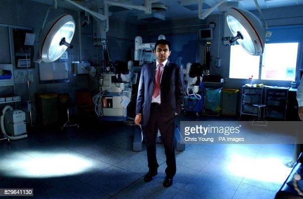 Prokar Dasgupta a consultant urologist at Guy's Hospital stands in front of the da Vinci robot in one of Guy's operating theatres in central London...