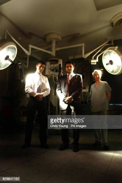 Prokar Dasgupta a consultant urologist at Guy's Hospital stands with transplant surgeon Nizam Mamode and theatre sister Maria Nightingale in front of...