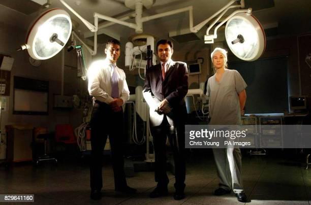 Prokar Dasgupta a consultant urologist flanked by transplant surgeon Nizam Mamode and theatre sister Maria Nightingale stand in front of the da Vinci...