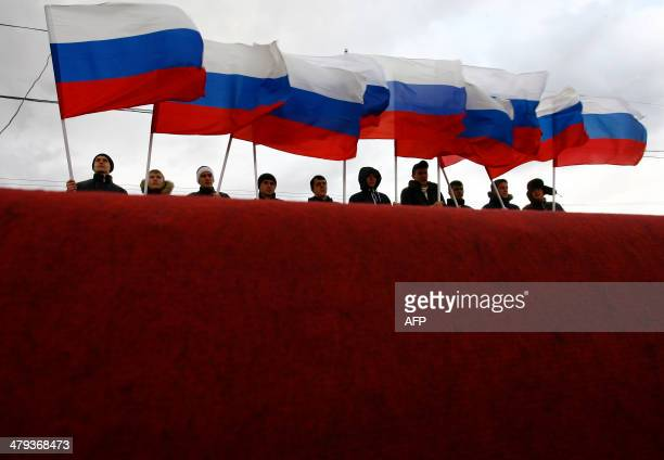 ProKremlin activists rally in southern Russian city of RostovonDon on March 18 to celebrate the incorporation of Crimea President Vladimir Putin...