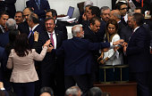 ProKurdish opposition Peoples' Democratic Party MPs react to Turkey's ruling AK Party as they vote in favor of an article of constitutional change...
