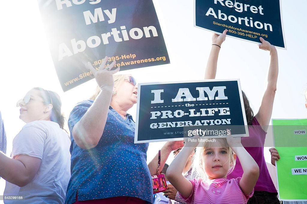 Pro-life activist, Nora, 6, of Harrisonburg, Va., demonstrates with her family and friends on the steps of the United States Supreme Court on June 27, 2016 in Washington, DC. In a 5-3 decision, the U.S. Supreme Court struck down one of the nation's toughest restrictions on abortion, a Texas law that women's groups said would have forced more than three-quarters of the state's clinics to close.