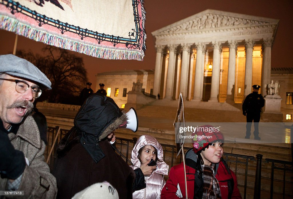 Pro-life activists use a bullhorn to interupt a vigil held by the National Organization For Women outside the U.S. Supreme Court on January 23, 2012 in Washington, DC. The vigil was held to mark the anniversary of the Roe v. Wade Supreme Court decision that legalized abortion.