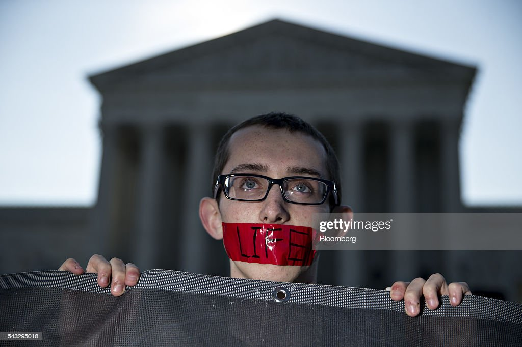 A pro-life advocate with the word 'Life' written on tape over his mouth stands outside the U.S. Supreme Court before rulings in Washington, D.C., U.S., on Monday, June 27, 2016. A divided U.S. Supreme Court struck down a Texas law that had threatened to close three-quarters of the states abortion clinics by putting new requirements on facilities and doctors. Photographer: Andrew Harrer/Bloomberg via Getty Images