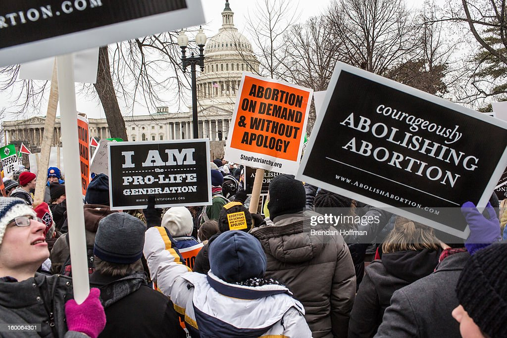 Pro-life and pro-choice protesters rally outside the U.S. Supreme Court, near the U.S. Capitol, during the March for Life on January 25, 2013 in Washington, DC. The pro-life gathering is held each year around the anniversary of the Roe v. Wade Supreme Court decision.