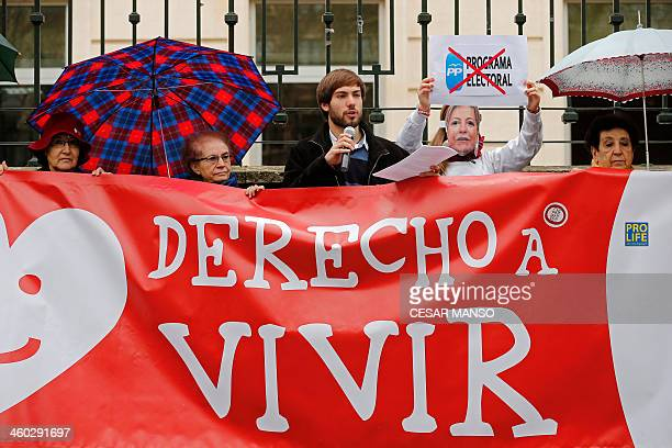 Prolife supporters from 'Derecho a vivir' association protest during a demonstration against abortion in Valladolid on January 3 2014 Spain's...