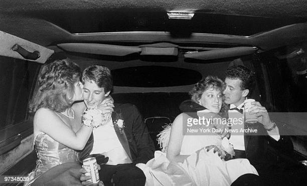 Prom couples Debbie McGrath and John Keenan and Sandy Rappaport and John Masera in the back of their limousine during Hauppauge High prom night