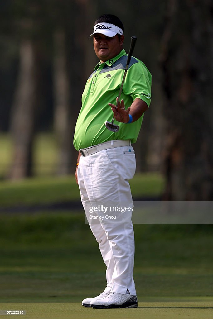 <a gi-track='captionPersonalityLinkClicked' href=/galleries/search?phrase=Prom+Meesawat&family=editorial&specificpeople=647876 ng-click='$event.stopPropagation()'>Prom Meesawat</a> of Thailand reacts over his putt on the 7th hole during the Pro-Am round of the 2014 Hong Kong open at The Hong Kong Golf Club on October 15, 2014 in Hong Kong, Hong Kong.