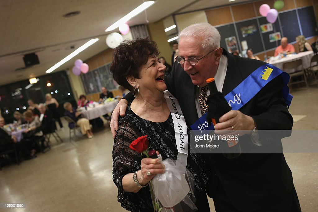 Prom queen Rae Cosenza, 77, and Paul Spadafina embrace after being announced queen and king at the 'Senior Citizens Senior Prom' on April 2, 2015 in the Staten Island borough of New York City. Some 100 senior citizens, many of them affected by Hurricane Sandy in 2012, came to the event, organized in the New Dorp High School cafeteria by the school's National Honor Society as well as non-profits Where to Turn and Beacon of Hope NY. The storm destroyed the seniors' Friendship community center, which still has not been rebuilt, and organizers held the event as a way for them to get together and socialize.