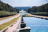View of long promenade in the park at Royal Palace of Caserta, Italy