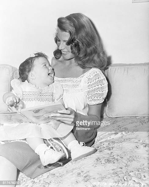 Prominent American film star Rita Hayworth is shown here spending time with her daughter Rebecca Welles