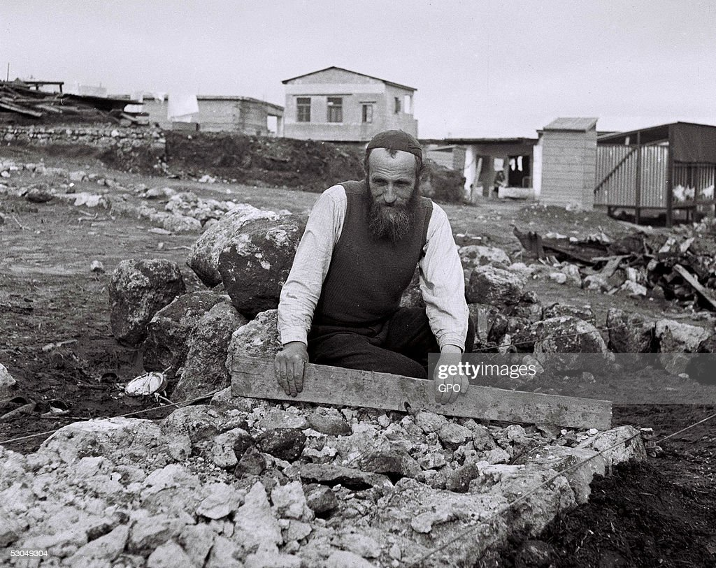 Prominent Jewish scholar Zisse Dworetz lays a path to new houses September 1, 1949 in the religious community of Kfar Habad outside of Tel Aviv in the newly-founded State of Israel.