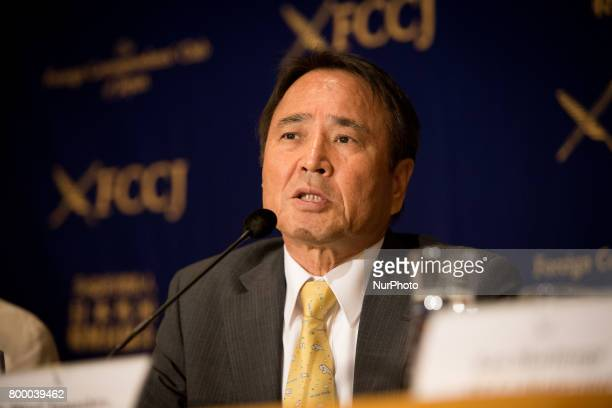 Prominent leader of the antibase movement Hiroji Yamashiro speaks with reporters in Tokyo Japan on June 23 2017 Mr Yamashiro was arrested and...