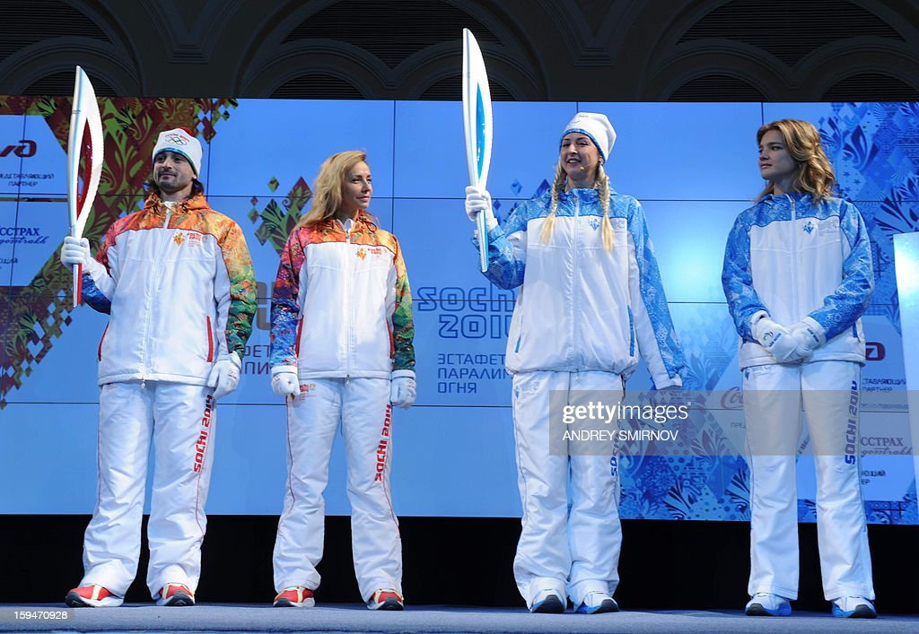Prominent Russian athletes, ice dancer, Olympic silver medalist, Ilia Averbukh (L) holds the newly unveiled Sochi 2014 Olympic Torch as paralympic swimmer, Olympic champion, Olesya Vladykina (2nd R), holds the newly unveiled Sochi 2014 Paralympic Torch in Moscow, on January 14, 2013, with Russian ice dancer, World and Olympic champion, Tatiana Navka (2nd L) and supermodel Natalya Vodyanova (R) attending. The Sochi 2014 Winter Olympics organisers unveiled today the torches that to be used for the traditional round-the-world relay leading up to the 2014 Winter Olympic and Paralympic Games.