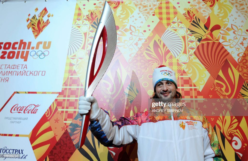 Prominent Russian ice dancer, Olympic silver medalist, Ilia Averbukh, poses for pictures with the newly unveiled Sochi 2014 Olympic Torch in Moscow, on January 14, 2013. The Sochi 2014 Winter Olympics organisers unveiled today the torch that to be used for the traditional round-the-world relay leading up to the 2014 Winter Olympic Games.