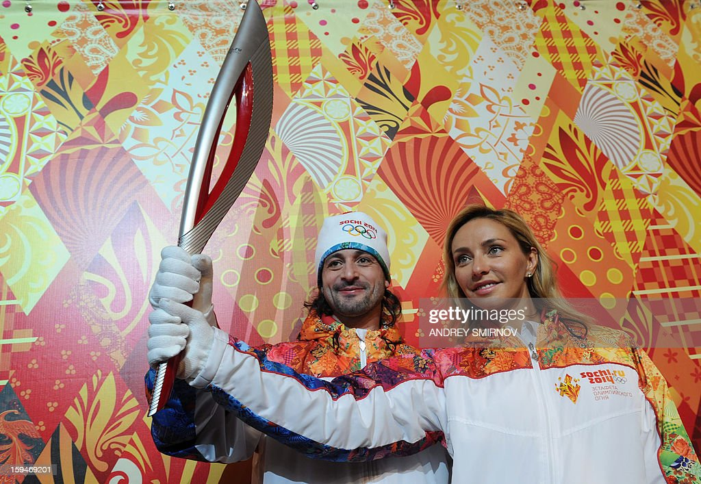 Prominent Russian ice dancers, World and Olympic champion, Tatiana Navka (R), and Olympic silver medalist, Ilia Averbukh, pose for pictures with the newly unveiled Sochi 2014 Olympic Torch in Moscow, on January 14, 2013. The Sochi 2014 Winter Olympics organisers unveiled today the torch that to be used for the traditional round-the-world relay leading up to the 2014 Winter Olympic Games. AFP PHOTO / ANDREY SMIRNOV