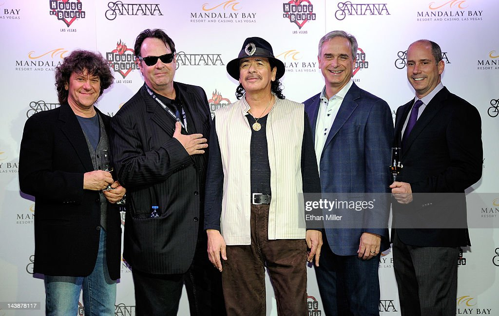 Promoter and co-founder of the original Woodstock Music & Art Fair Michael Lang, actor and House of Blues co-founder Dan Aykroyd, recording artist Carlos Santana, President and Chief Operating Officer of Mandalay Bay Chuck Bowling and CEO of Casa Noble Tequila Jose 'Pepe' Hermosillo share a toast at the House of Blues inside the Mandalay Bay Resort & Casino during a mud ceremony May 4, 2012 in Las Vegas, Nevada. The ceremony involved combining dirt from the town of Clarksdale in the Mississippi Delta with dirt from Bethel, New York from the site of the Woodstock Festival and mud from Santana's hometown of Autlan de Navarro, Jalisco in Mexico to symbolize his two-year residency at the music venue.