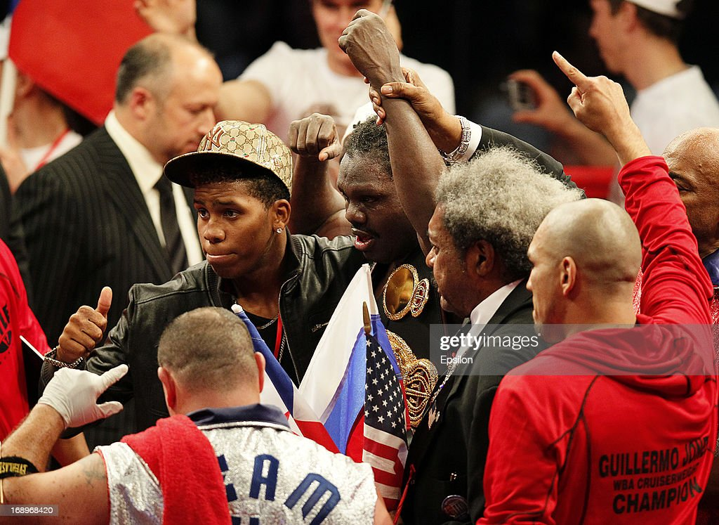 Promoter Don King (2R) and Guillermo Jones (C) of Panama celebrate after defeating Denis Lebedev of Russia during their WBA cruiserweight title bout at the Crocus City Hall on May 17, 2013 in Moscow, Russia.