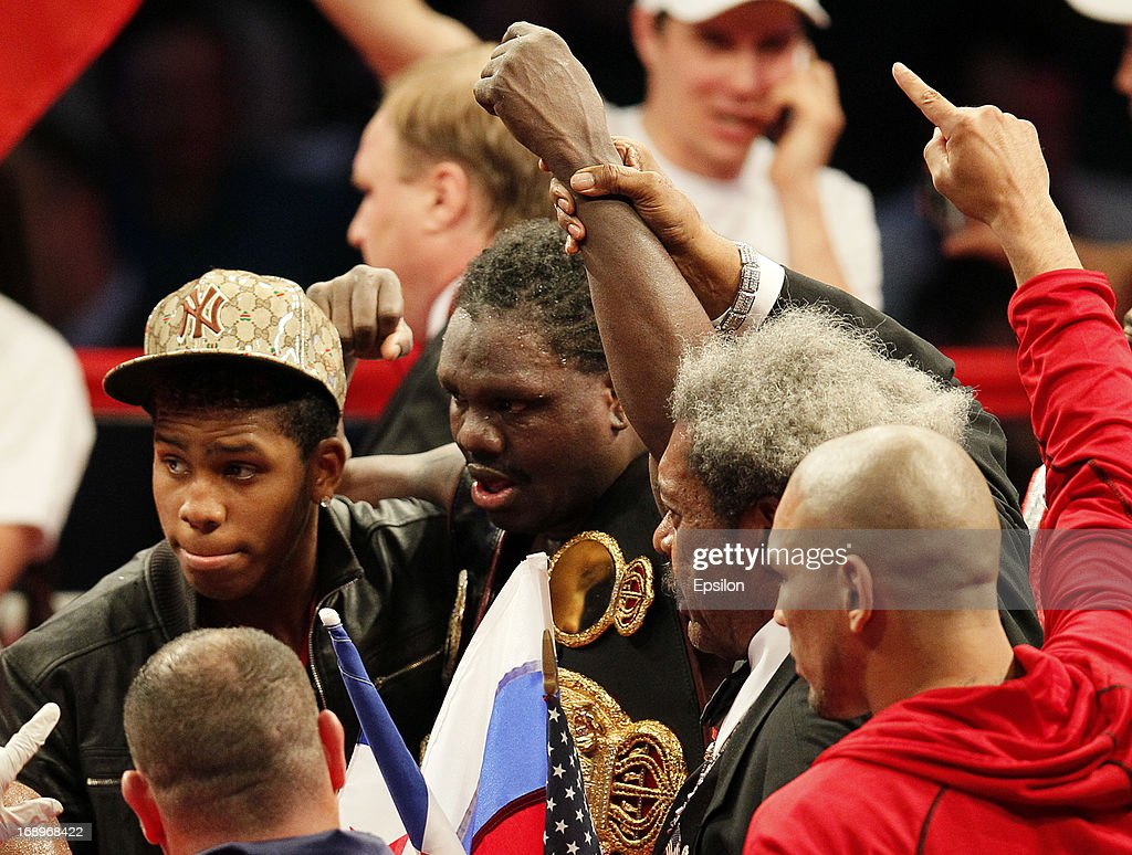 Promoter <a gi-track='captionPersonalityLinkClicked' href=/galleries/search?phrase=Don+King&family=editorial&specificpeople=171346 ng-click='$event.stopPropagation()'>Don King</a> (2R) and <a gi-track='captionPersonalityLinkClicked' href=/galleries/search?phrase=Guillermo+Jones&family=editorial&specificpeople=244103 ng-click='$event.stopPropagation()'>Guillermo Jones</a> (C) of Panama celebrate after defeating Denis Lebedev of Russia during their WBA cruiserweight title bout at the Crocus City Hall on May 17, 2013 in Moscow, Russia.