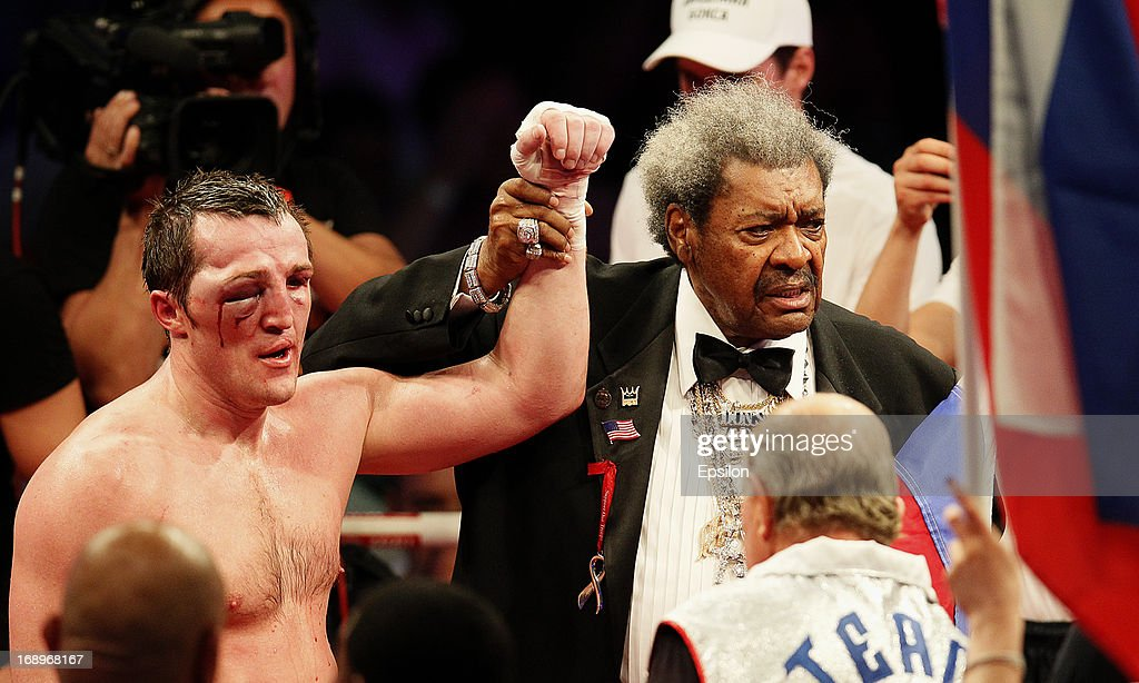 Promoter Don King (R) lifts the arm of Denis Lebedev of Russia after he was defeated by Guillermo Jones of Panama during their WBA cruiserweight title bout at the Crocus City Hall on May 17, 2013 in Moscow, Russia.