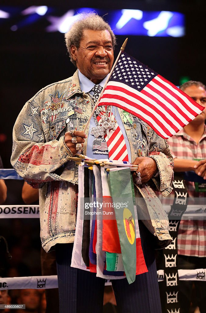 Promoter <a gi-track='captionPersonalityLinkClicked' href=/galleries/search?phrase=Don+King&family=editorial&specificpeople=171346 ng-click='$event.stopPropagation()'>Don King</a> stands in the ring for the national anthem before Bermane Stiverne and Chris Arreola met in their WBC Heavyweight Championship match at Galen Center on May 10, 2014 in Los Angeles, California. Stiverne won in a six round technical knockout.