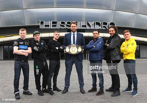 Promoter Eddie Hearn looks on as Charlie Flynn Willie Limond Ricky Burns Michele De Rocco Tyrone Nurse and Lewis Paulin pose during the Ricky Burns...