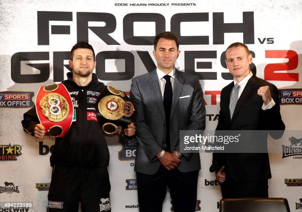 Promoter Eddie Hearn stands inbetween Carl Froch and George Groves as they go head to head during a press conference to announce the upcoming WBA IBF...