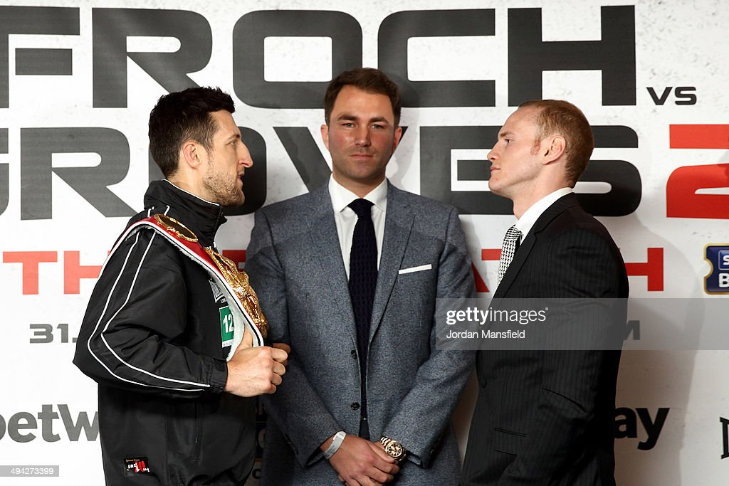 Promoter Eddie Hearn stands inbetween <a gi-track='captionPersonalityLinkClicked' href=/galleries/search?phrase=Carl+Froch&family=editorial&specificpeople=241345 ng-click='$event.stopPropagation()'>Carl Froch</a> and <a gi-track='captionPersonalityLinkClicked' href=/galleries/search?phrase=George+Groves&family=editorial&specificpeople=4006710 ng-click='$event.stopPropagation()'>George Groves</a> as they go head to head during a press conference to announce the upcoming WBA & IBF Super Middleweight World Championship fight between <a gi-track='captionPersonalityLinkClicked' href=/galleries/search?phrase=Carl+Froch&family=editorial&specificpeople=241345 ng-click='$event.stopPropagation()'>Carl Froch</a> and <a gi-track='captionPersonalityLinkClicked' href=/galleries/search?phrase=George+Groves&family=editorial&specificpeople=4006710 ng-click='$event.stopPropagation()'>George Groves</a> at Wembley Stadium on May 29, 2014 in London, England.
