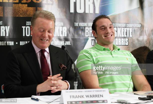 Promoter Frank Warren and Tyson Fury during the press conference at Fredericks Restaurant London