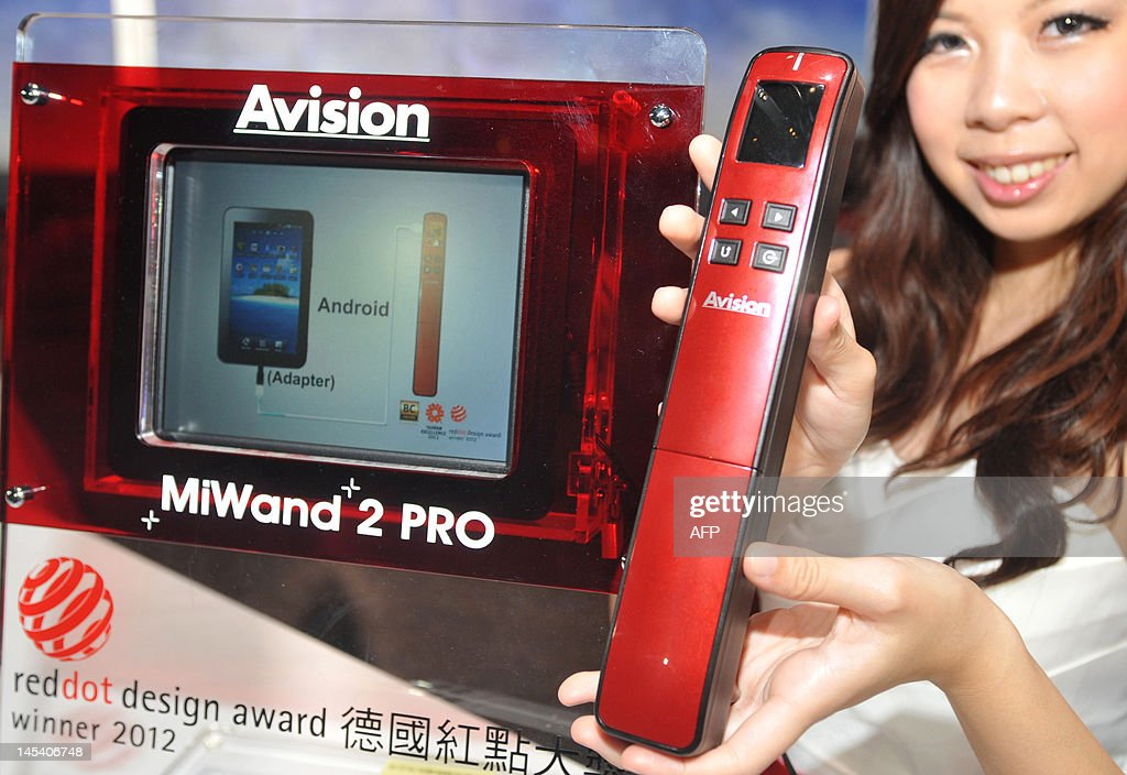 A promoter holds an Avision MiWand 2 pro mobile scanner during a pre-show press conference for the 2012 Computex Taipei on May 29, 2012. Computex is Asia's biggest annual IT trade fair which opens on June 5, 2012. AFP PHOTO / Mandy CHENG