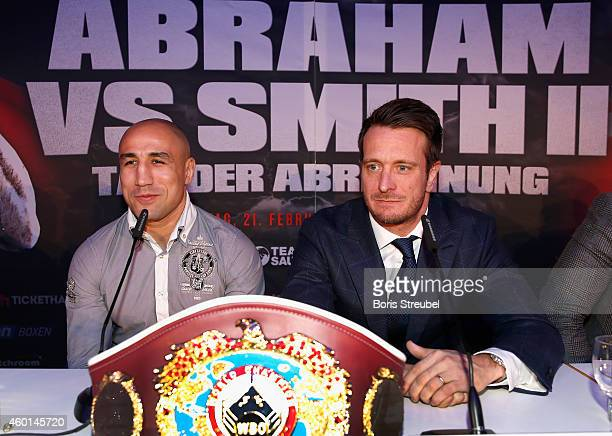 Promoter Kalle Sauerland and WBO Super Middleweight World Champion Arthur Abraham of Germany attend the press conference at O2 world on December 8...