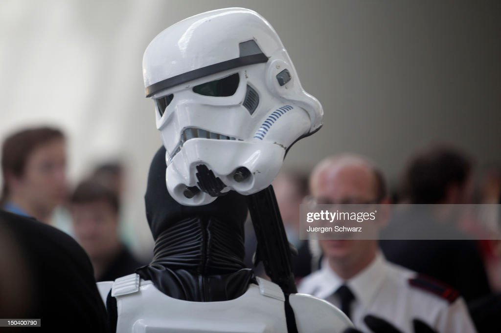 A promoter of Star Wars carries his helmet during a brake at the Gamescom 2012 gaming trade fair on August 16, 2012 in Cologne, Germany. Gamescom is Europe's largest gaming expo with 600 international developers exhibiting their latest products. Around 250,000 visitors are expected to attend the four-day event being held between August 15-19.