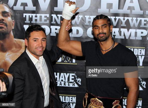 Promoter Oscar De La Hoya of Golden Boy Promotions and WBA heavyweight champion David Haye of England address the media at China Grill inside...