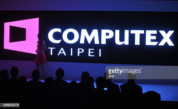 A promoter walks on stage during the 2013 Computex in Taipei on June 4 2013 Computex is Asia's biggest annual IT trade fair which opens on June 4 AFP...