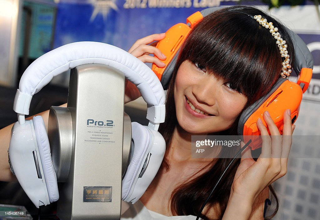 A promoter wears a Pro.2 headphone during a pre-show press conference for the 2012 Computex Taipei on May 29, 2012. Computex is Asia's biggest annual IT trade fair which opens on June 5, 2012. AFP PHOTO / Mandy CHENG